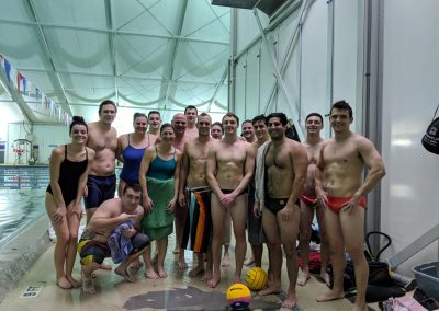 North Charleston Water Polo Team smiling by the pool