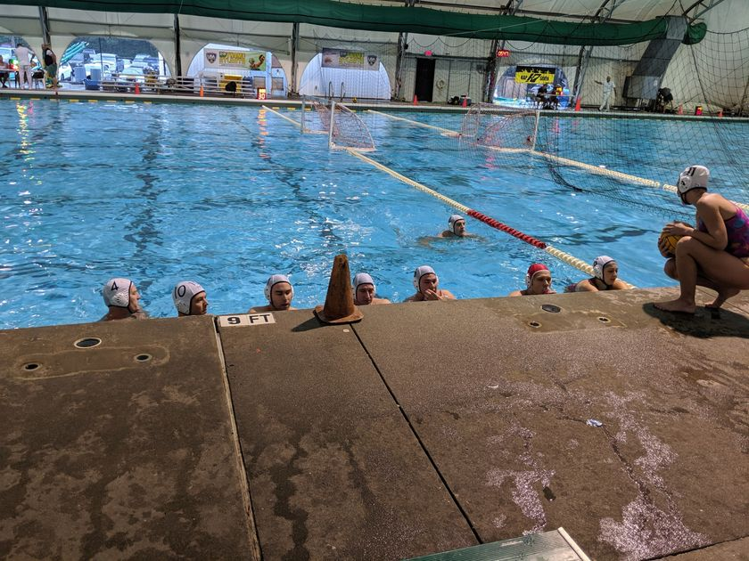 North Charleston Water Polo Team listening to coach